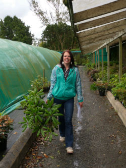Julie collecting plants from the Nursery